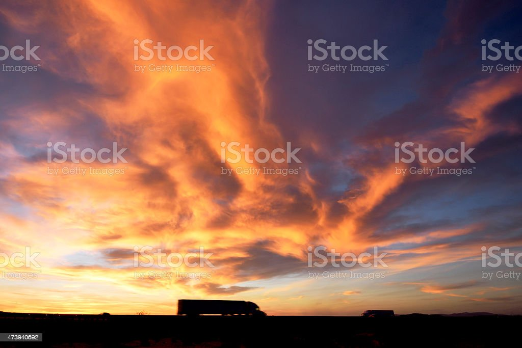 Truck on Highway under dramatic sky stock photo