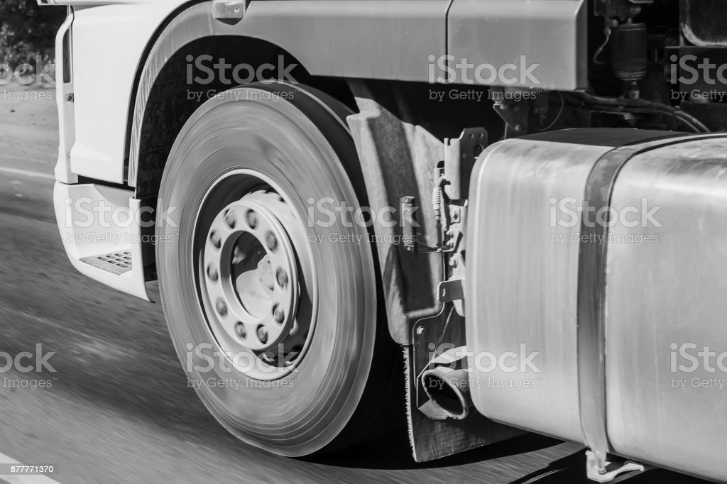 Truck on road close-up stock photo