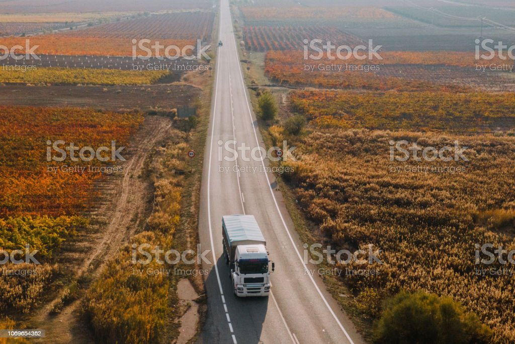 A view from above of a truck on a road
