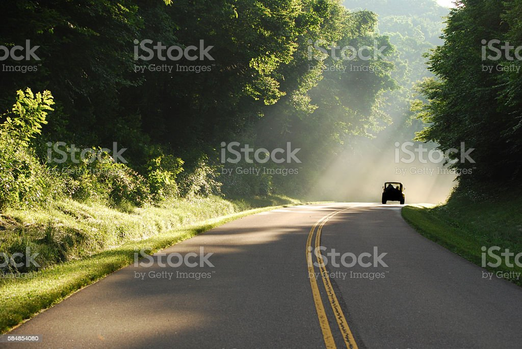 Truck On Road In Rays Of Sunshine stock photo