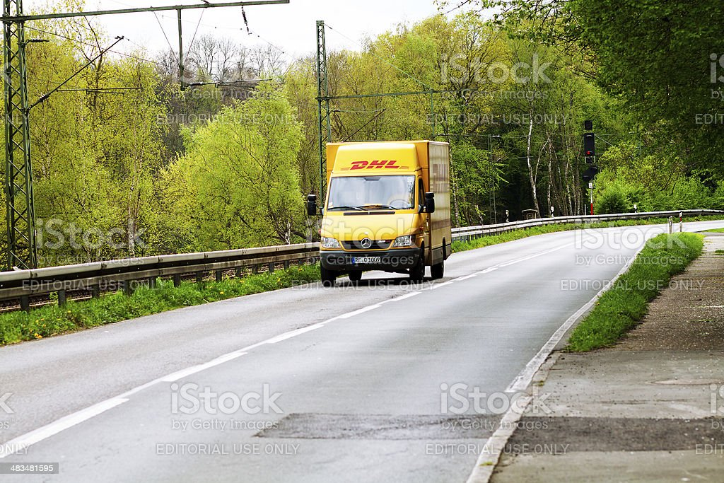 DHL truck on road stock photo