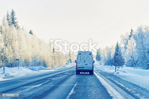 1127834626 istock photo Truck on Snow Road in winter Finland Lapland 976689212