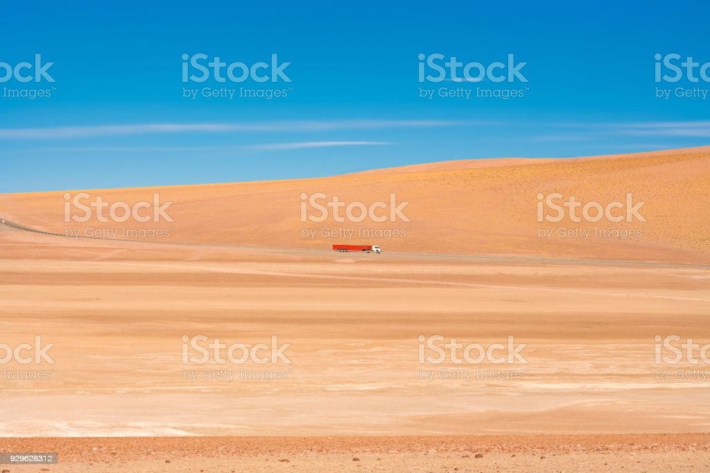 Truck on the desert on the road to Paso Jama in the Altiplano at an...
