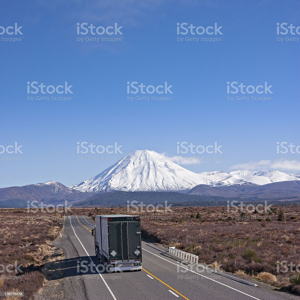 Truck on the Desert Road, New Zealand with Mount Ngauruhoe royalty-free stock photo