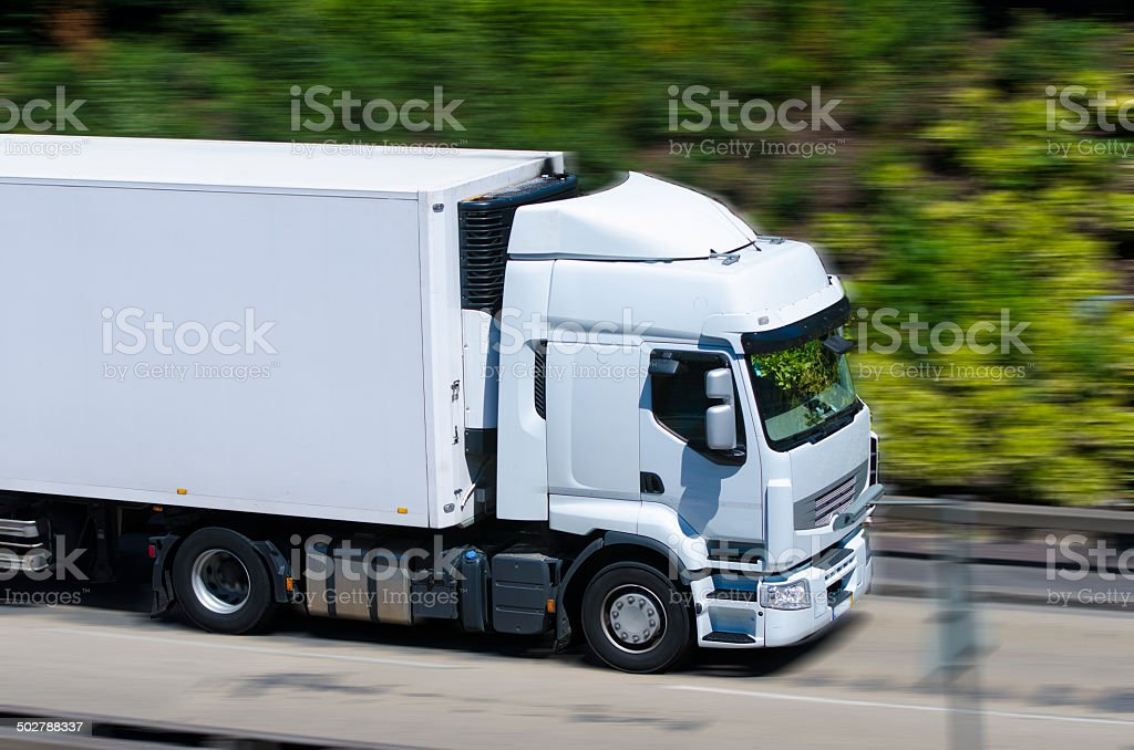 Truck on the highway with blurred motion stock photo