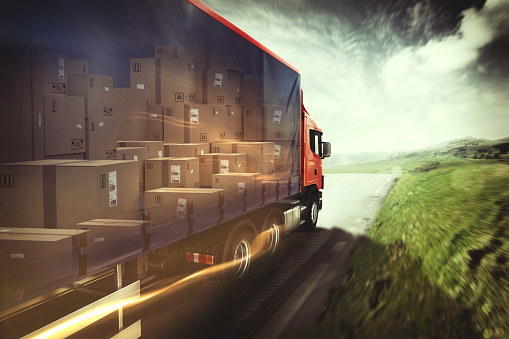 Truck on the road with load of boxes. 3D Rendering
