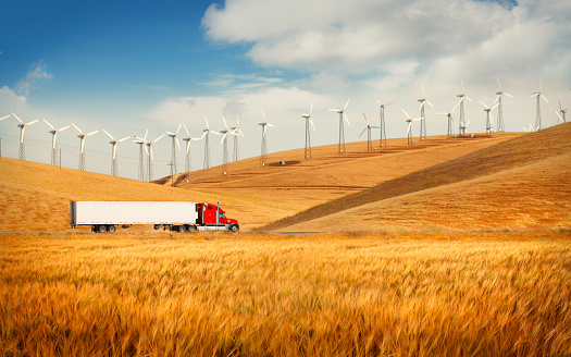 istock Truck on the road going in the american countryside 1014784386
