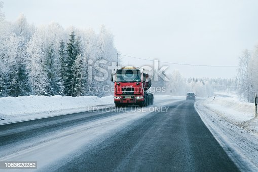 1127834626 istock photo Truck on the Snowy winter Road in Finland Lapland EU 1083620282