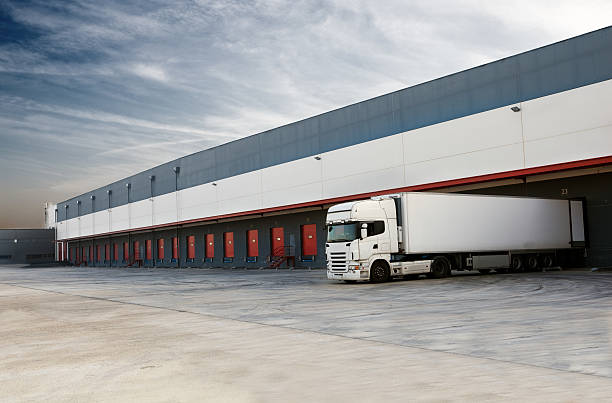 truck. - lorries unloading stock photos and pictures