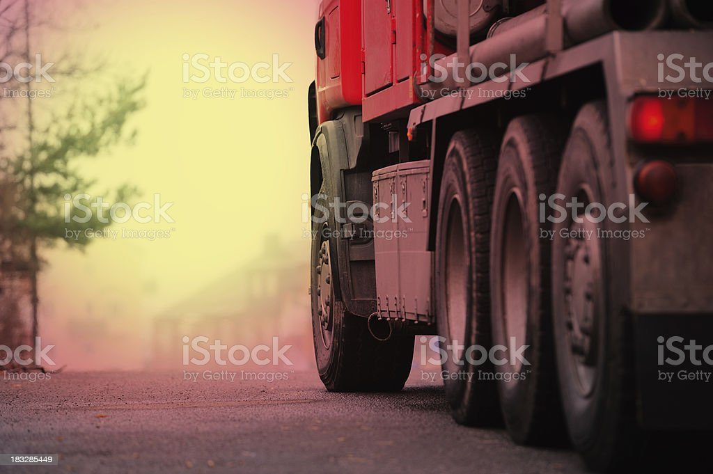 Truck ready to depart, city silhouette in background stock photo