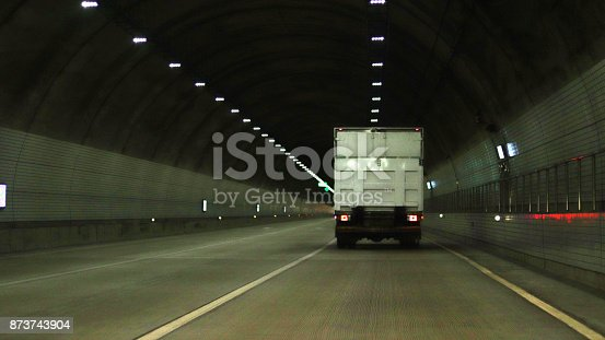 1023119734 istock photo A truck running through a tunnel 873743904
