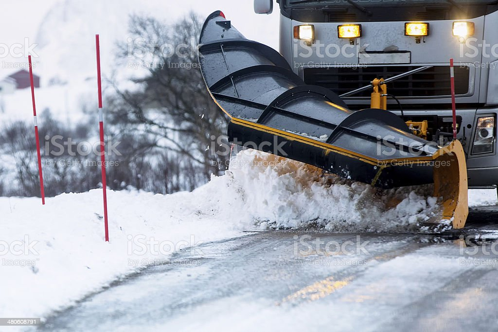 truck snow removal plow snowstorm spreader after a storm stock photo