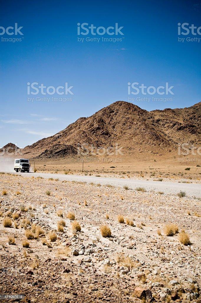 Truck speeding on desert road royalty-free stock photo