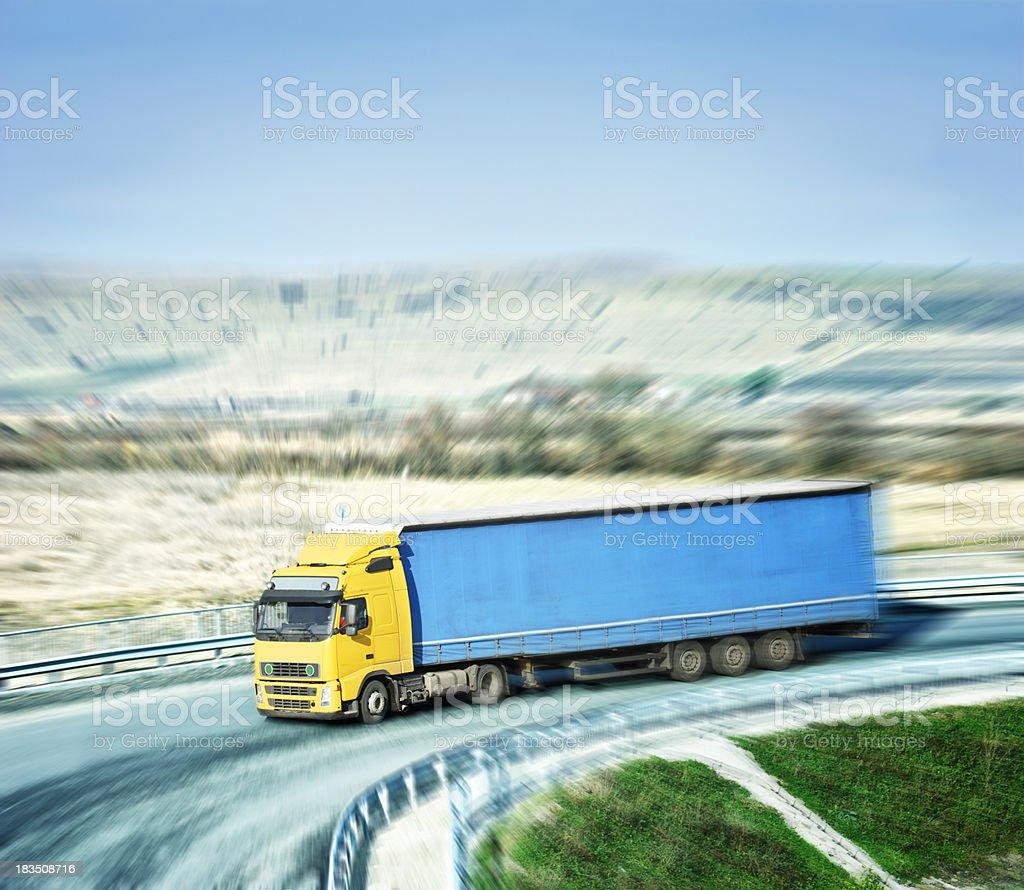 truck speeding on highway stock photo