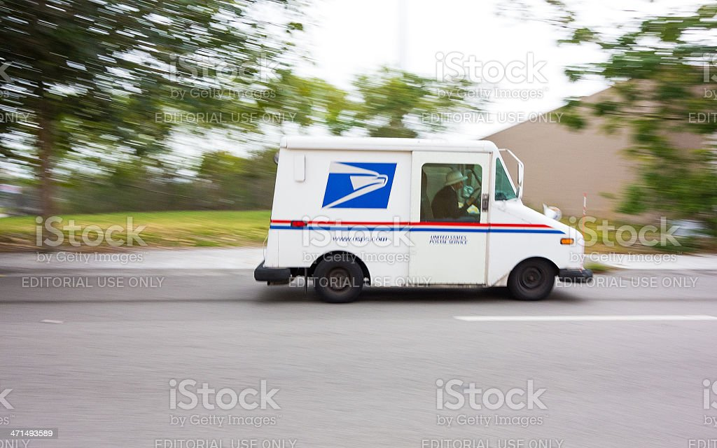 USPS truck speeding stock photo