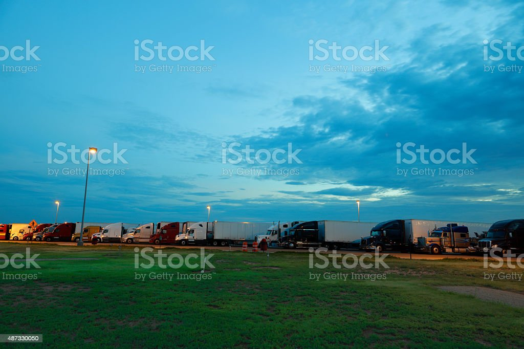 Truck stop at dusk stock photo