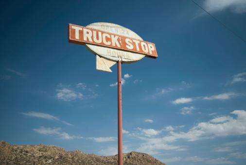 Truck Stop sign on a desert highway.