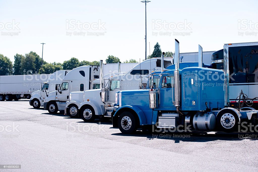 Truck stop with row of big rigs semi trucks stock photo