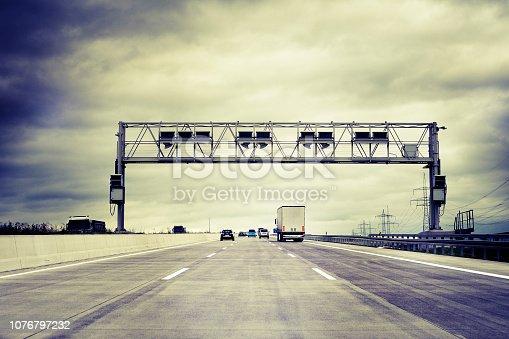 Truck toll system, german highway - control gantry, some minor motion blurring