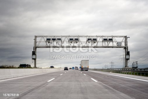 Truck toll system, german highway - control gantry, some minor motion blurring