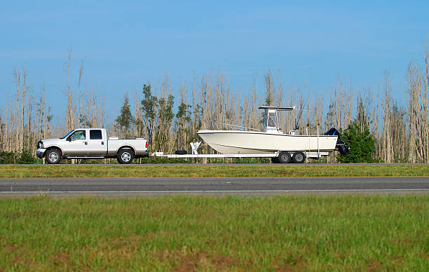 Truck towing boat  vehicle trailer stock pictures, royalty-free photos & images