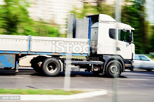 istock truck traffic to pass on the city road, speed 649195006