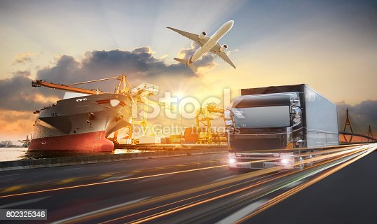 istock Truck transport container on the road to the port 802325346