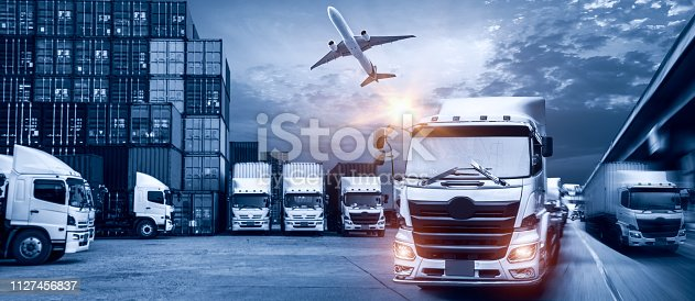 istock Truck transport container on the road to the port with Logistic transportation of Container Cargo ship and Cargo plane, Business Logistics transportation concept 1127456837