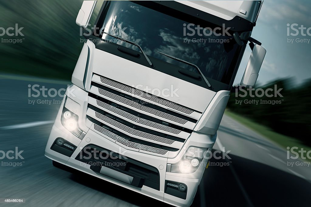 Truck Transport - Frontside Driving a Semi-Truck along the highway road. 2015 Stock Photo