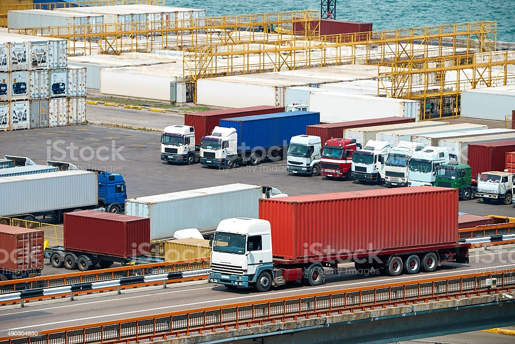 truck transportation container from ship near sea stock photo