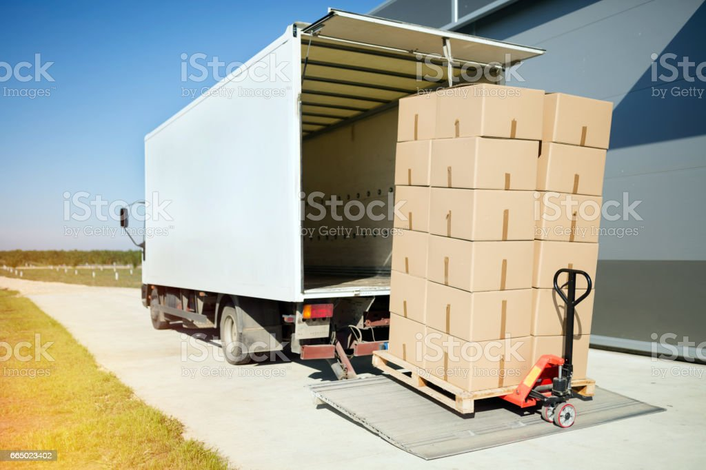 Truck transporting goods packed in boxes from warehouse stock photo