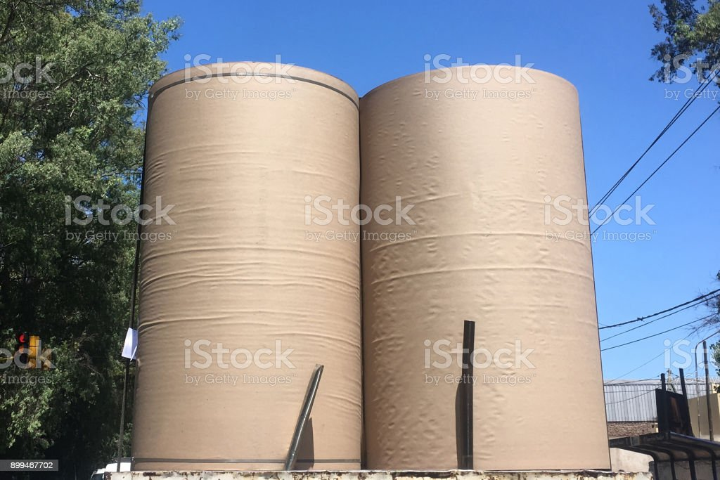 Truck transporting industrial roll of paper stock photo