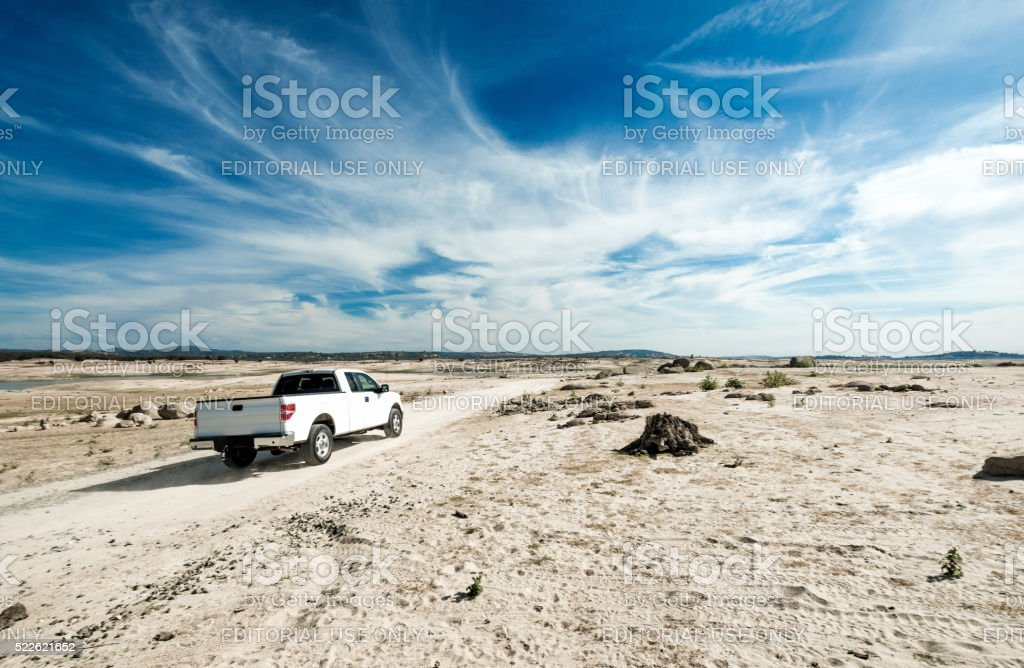 Truck Travels though Drought Stricken Folsom Lake stock photo