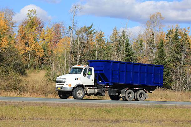 Truck with a dumpster on an interstate highway. stock photo
