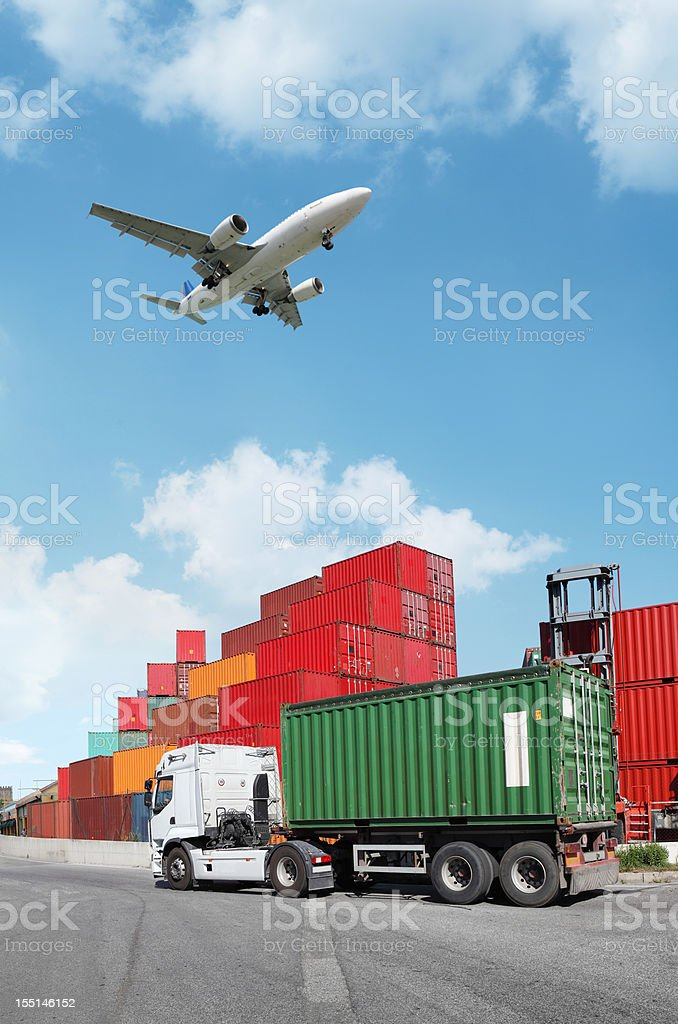 Truck with container and flying airplane royalty-free stock photo