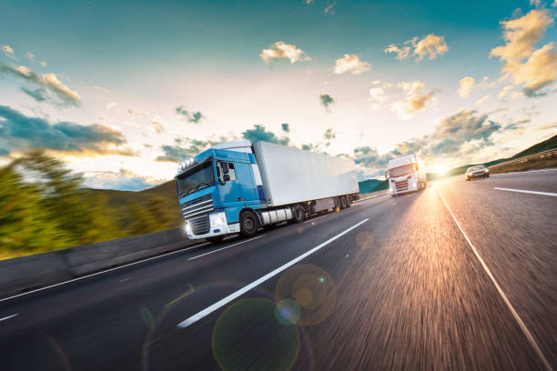 Truck with container on road, cargo transportation concept. stock photo