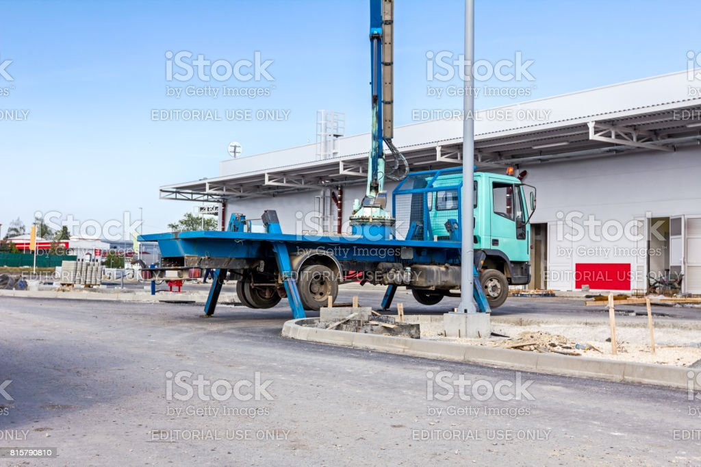 Truck with extended side outrigger stabilizer give support to mobile telescopic crane for scaffold stock photo