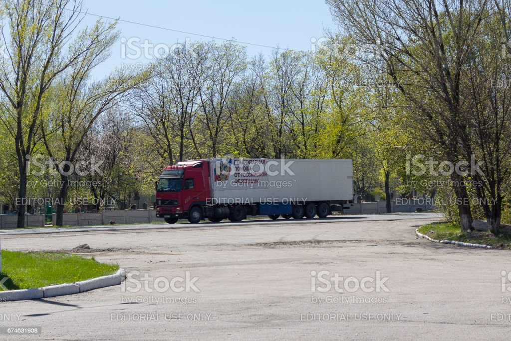 Truck with humanitarian cargo on the city road stock photo