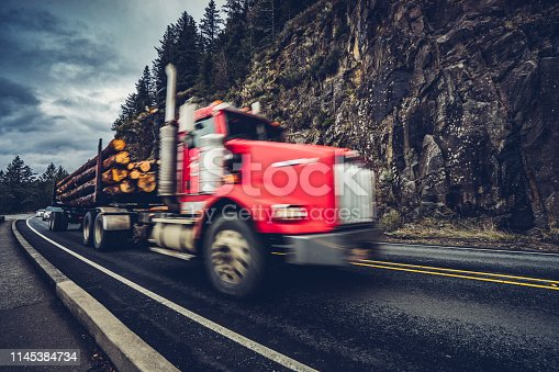 Truck with logs on Route 101 along Oregon Coast in California,United States.