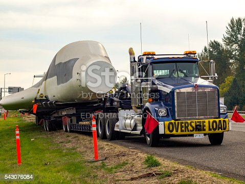 istock Truck with Oversize Load Sign Carring B-1 Bomber I-5 Oregon 543076084