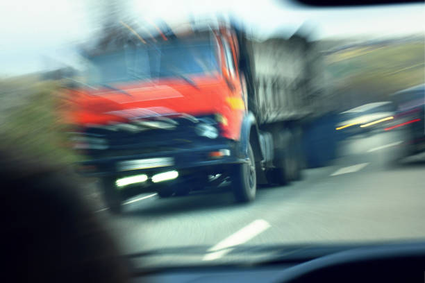 truck with red cab on the road in motion. Accident rate. View from the cab of the car truck with red cab on the road in motion. Accident rate. View from the cab of the car traffic accident stock pictures, royalty-free photos & images