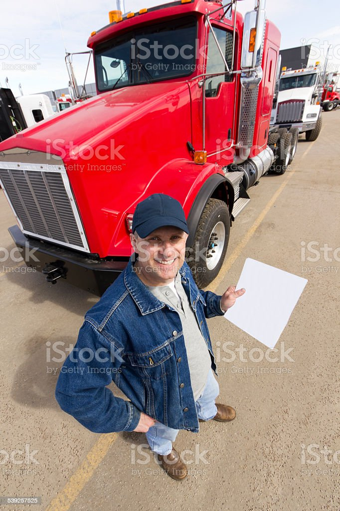 A royalty free image from the trucking industry of a truck driver and...