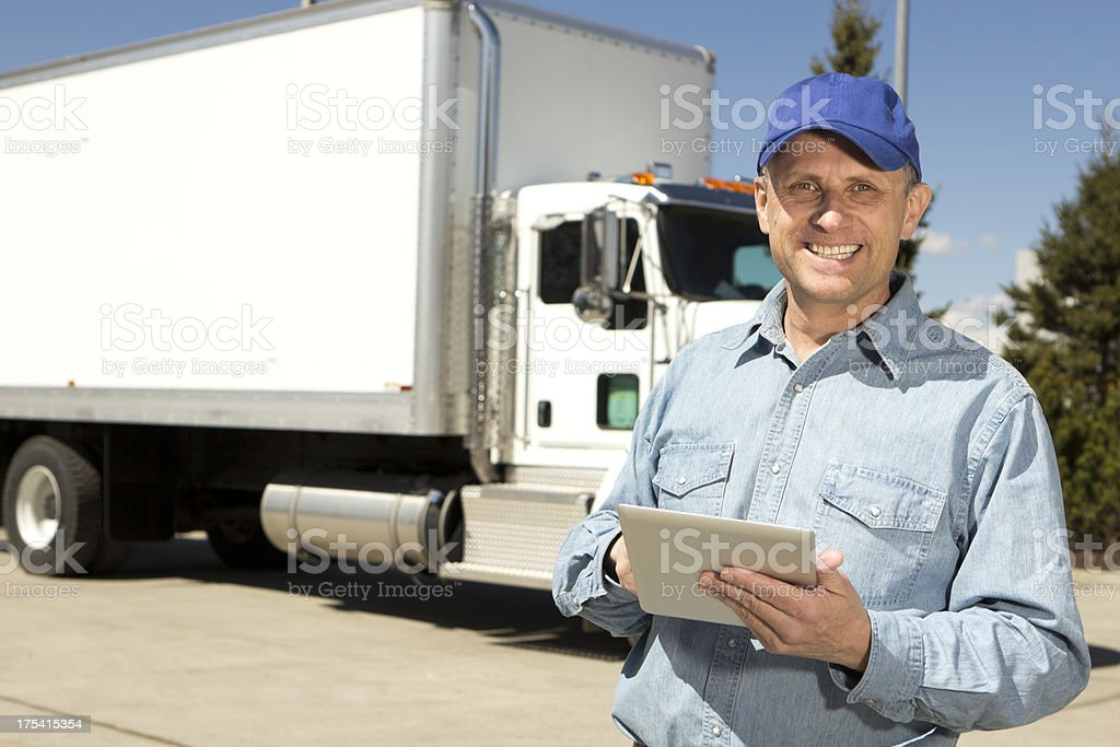 Trucker and Computer Tablet royalty-free stock photo