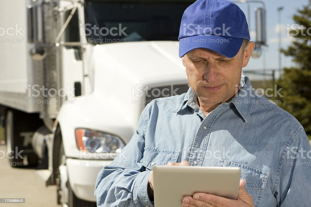 Trucker and Silver Tablet royalty-free stock photo