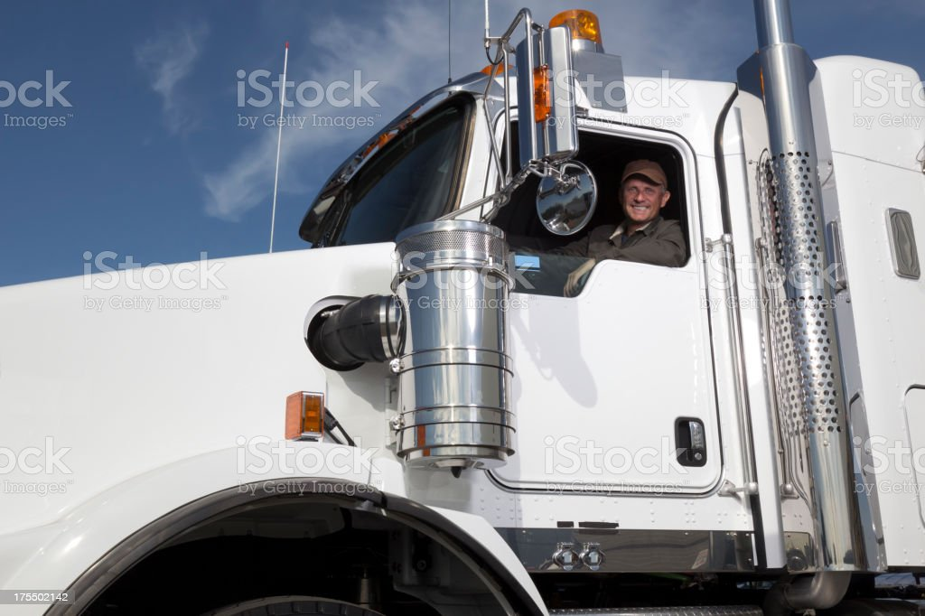 Trucker and truck royalty-free stock photo
