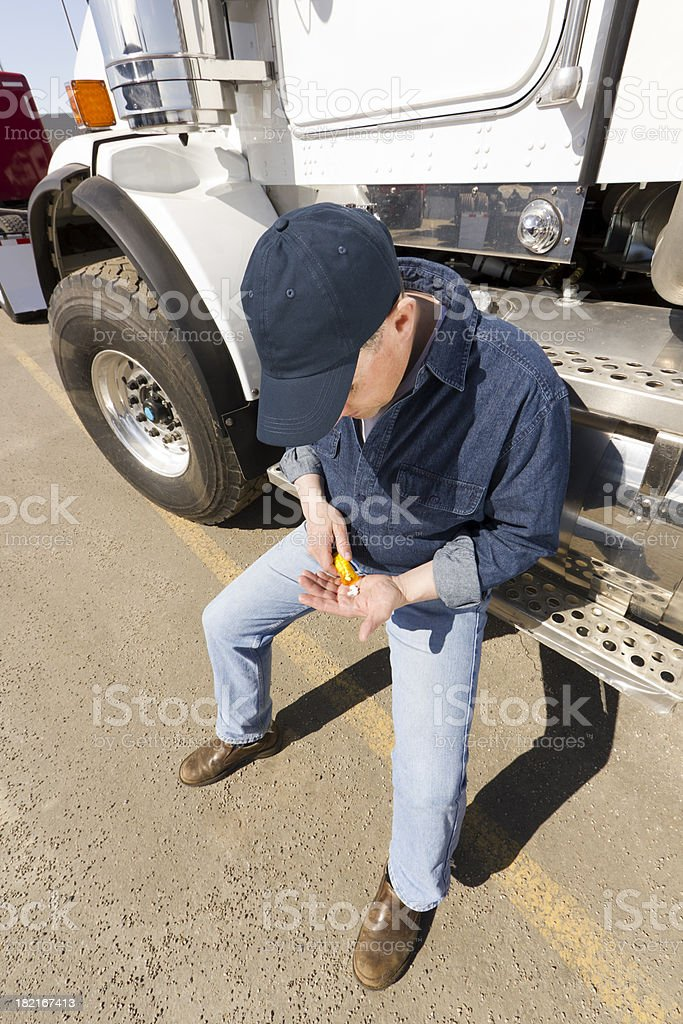 Trucker Taking Pills royalty-free stock photo
