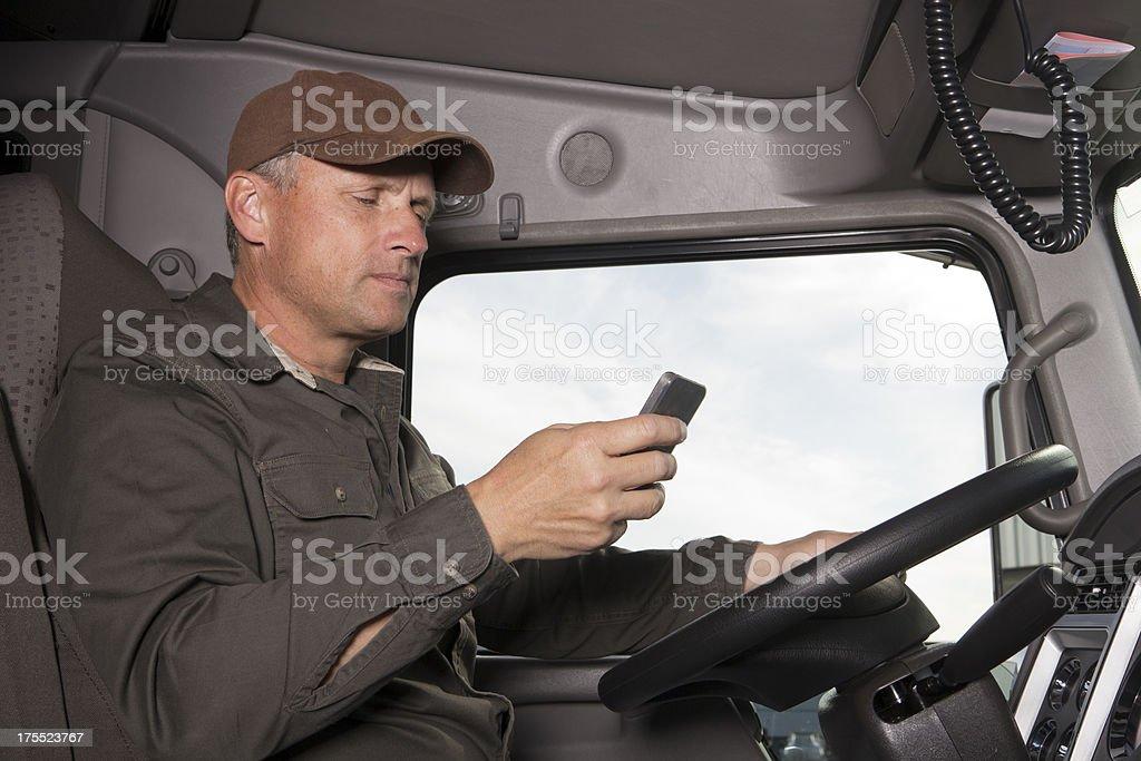 Trucker Texting stock photo