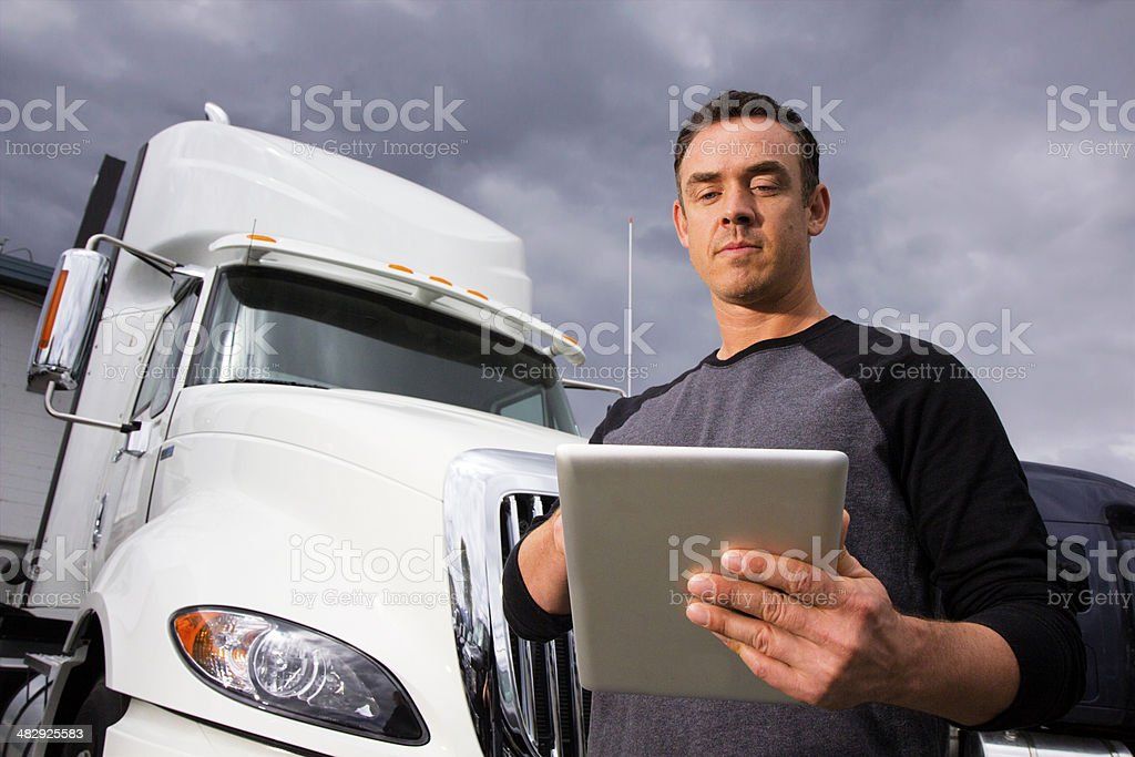 Trucker Using a Tablet stock photo