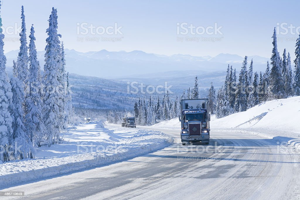 Trucking in the Remote Winter Wilderness stock photo