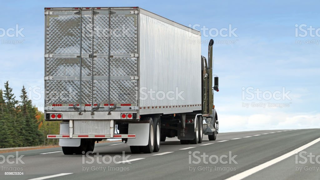Trucking Industry, Semi Truck Hauling Freight On Interstate Highway, 16x9 Format stock photo